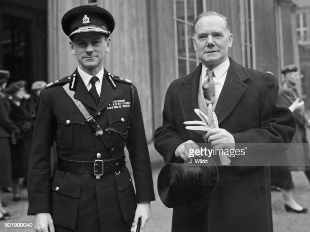 Richard Catling Commissioner of Police in Kenya and Leonard Burt Commander of the Metropolitan Police leave Buckingham Palace in London after their...