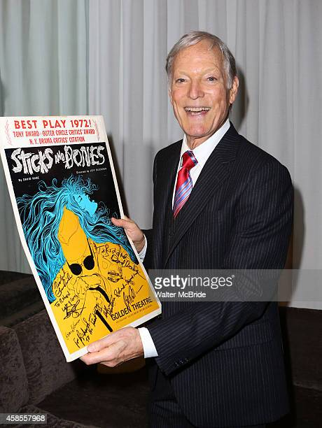 Richard Chamberlain poses with the 1972 Original Broadway cast poster attends the OffBroadway Opening Night after party for the New Group production...