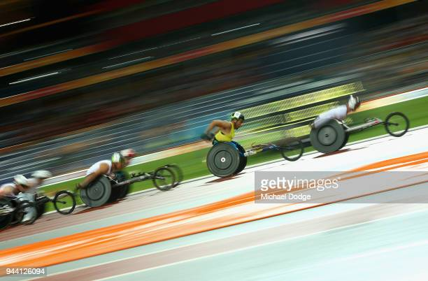 Richard Chiassaro of England and Kurt Fearnley of Australia compete in the Men's T54 1500 metres during the Athletics on day six of the Gold Coast...