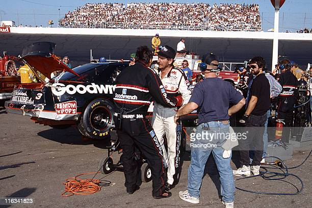 Richard Childress Racing gasman Danny 'Chocolate' Myers tries to calm down his driver Dale Earnhardt following a crash in the SplitFire Spark Plug...