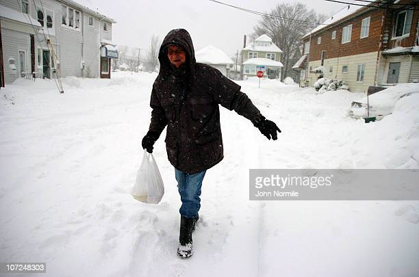 Richard Clabeaus navigates snow-covered streets after a five mile wide band of lake-effect snow dumped more than two feet of snow and closed a...