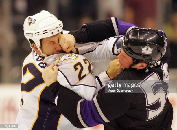 Richard Clune of Los Angeles Kings punches Jordin Tootoo of the Nashville Predators during their fight in the second period of their NHL game at the...