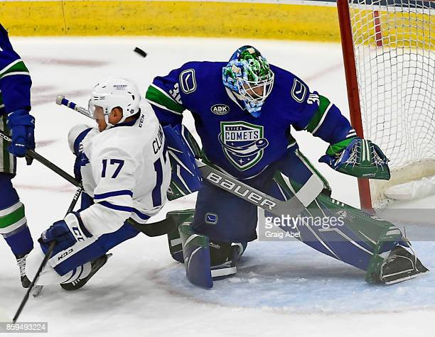Richard Clune of the Toronto Marlies collides with Thatcher Demko of the Utica Comets during AHL game action on October 7 2017 at Ricoh Coliseum in...