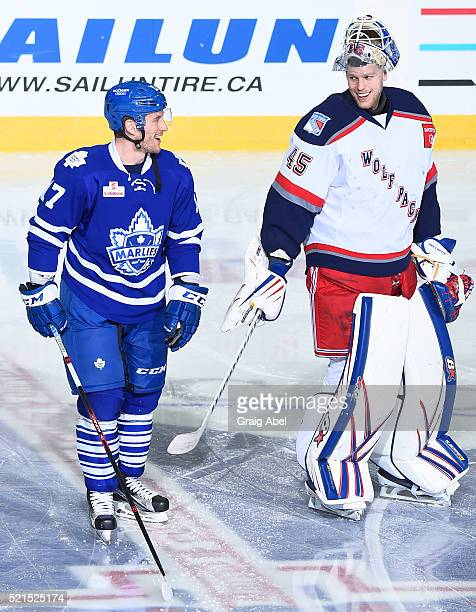 Richard Clune of the Toronto Marlies has a laugh with Magnus Hellberg of the Hartford Wolf Pack during warmup on April 13 2016 at the Ricoh Coliseum...