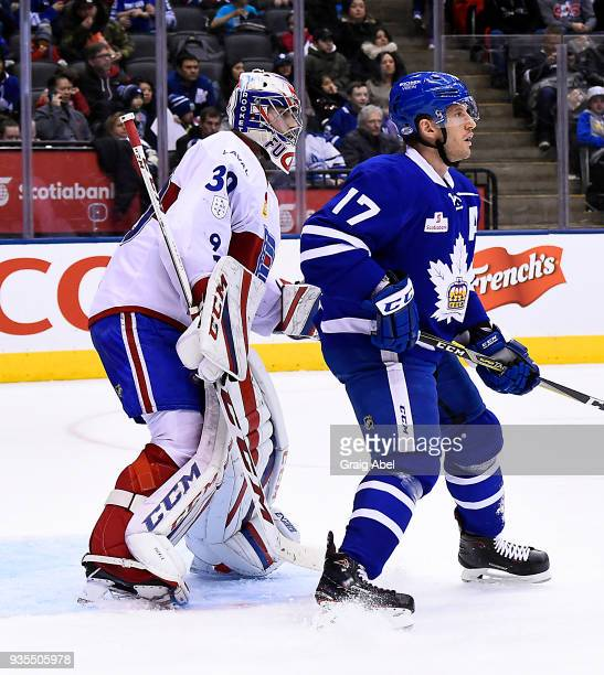 Richard Clune of the Toronto Marlies puts a screen on goalie Zachary Fucale of the Laval Rocket during AHL game action on March 12 2018 at Air Canada...