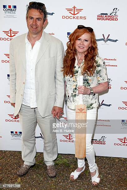 Richard Coates and Carol Decker attends at the Dockers Flannels For Heroes Charity Cricket Match and Garden Party at the Bruton Gardens Royal...