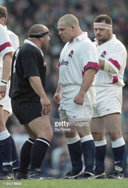 Richard Cockerill of England confronts Norm Hewitt of New Zealand during the Haka as Darren Garforth looks on before an All Blacks tour match against...