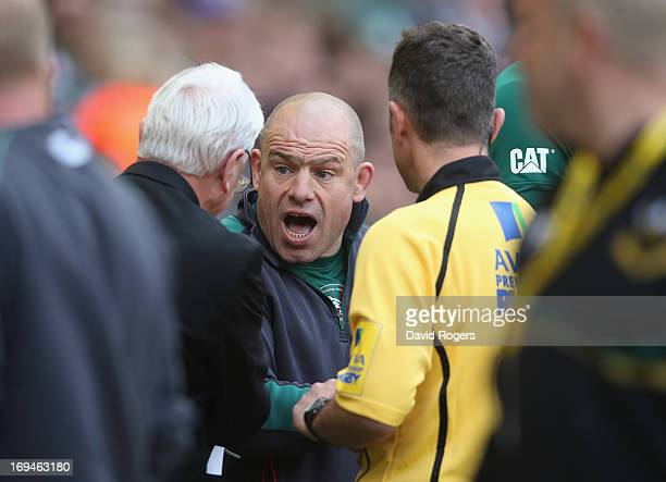 Richard Cockerill the Leicester Tigers director of rugby argues with refereeing official Ed Morrison after a tackle by Courtney Lawes on Toby Flood...