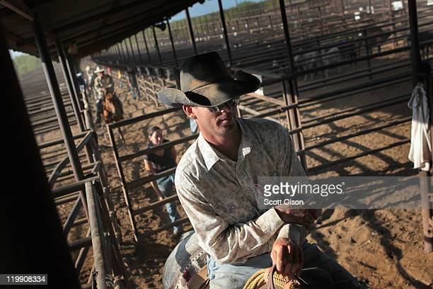 Richard Coleman helps to move cattle into pens after they had been sold at the Abilene Livestock Auction July 26 2011 in Abilene Texas A severe...