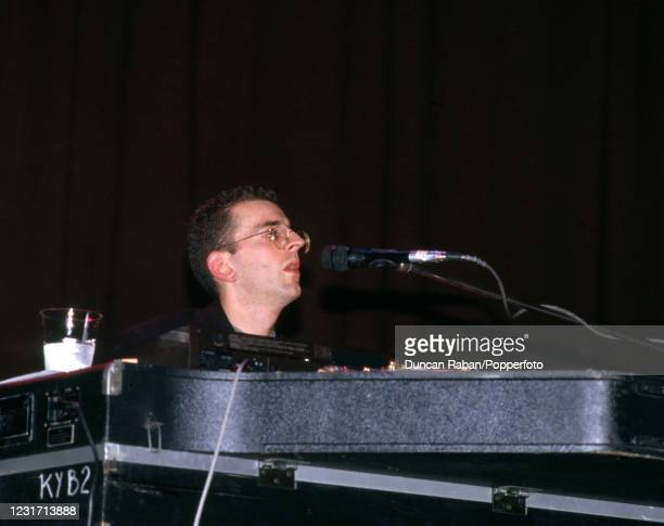 Richard Coles of British pop duo The Communards, playing the piano on stage, circa 1987.
