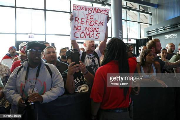 Richard Colon father of boxer Prichard Colon protests during the Premier Boxing Championship WBC World Welterweight Championship weighin at Barclays...