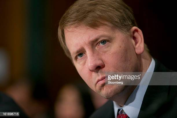 Richard Cordray director of the Consumer Financial Protection Bureau listens during a Senate Banking Committee hearing in Washington DC US on...