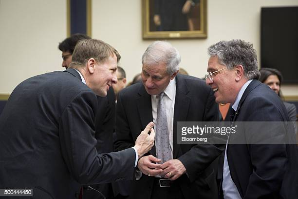 Richard Cordray director of the Consumer Financial Protection Bureau from left speaks with Martin Gruenberg chairman of the Federal Deposit Insurance...