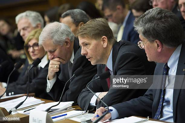 Richard Cordray director of the Consumer Financial Protection Bureau second right testifies during a House Financial Services Committee hearing with...