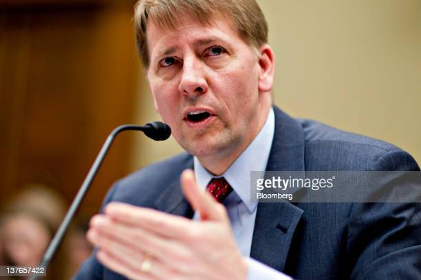 Richard Cordray director of the US Consumer Financial Protection Bureau testifies during a House Oversight and Government Reform subcommittee hearing...