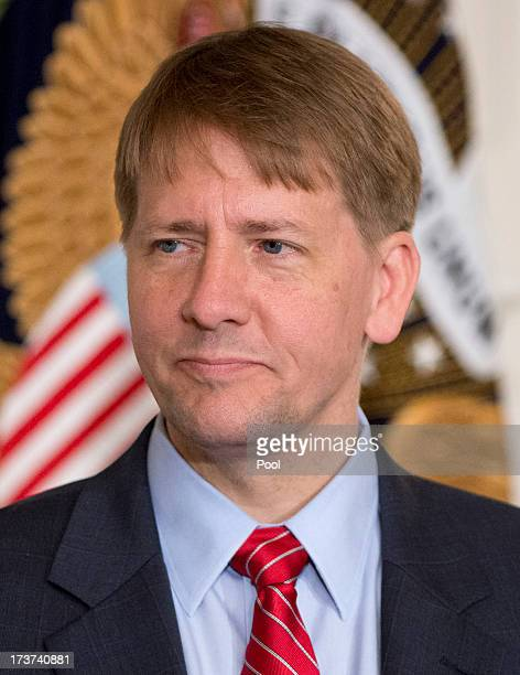 Richard Cordray new Director of the Consumer Financial Protection Bureau listens as United States President Barack Obama delivers a statement on...