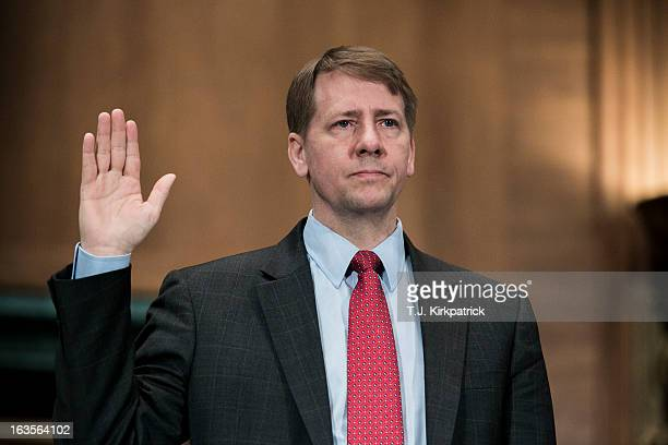 Richard Cordray nominee for director of the Consumer Financial Protection Bureau is sworn in before testifying at a confirmation hearing before the...