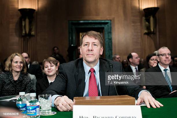 Richard Cordray nominee for director of the Consumer Financial Protection Bureau prepares to testify at a confirmation hearing before the Senate...