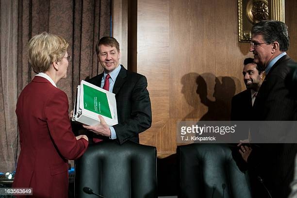 Richard Cordray nominee for director of the Consumer Financial Protection Bureau arrives to testify at a confirmation hearing before the Senate...