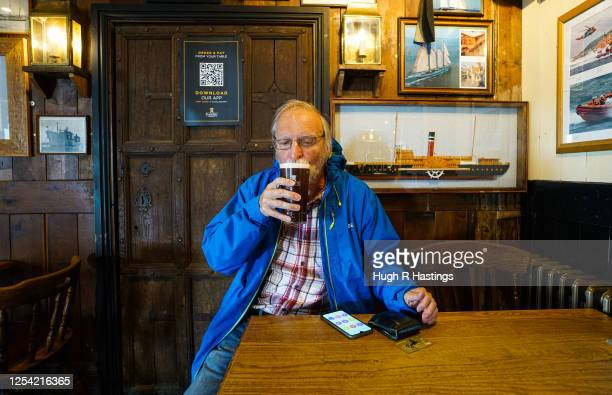 Richard Cranage returns to his local pub the Chain Locker for a pint of his favourite ale after it reopened for business on July 4 2020 in Falmouth...