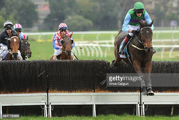 Richard Cully riding Krase jumps the last steeple before winning Race 3 The Australian Steeplechase during Melbourne Racing at Sandown Lakeside on...