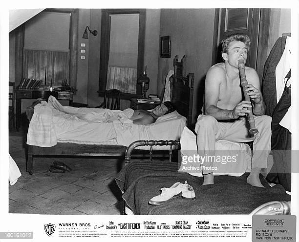 Richard Davalos looking annoyed as James Dean keeps him up by playing the flute in a scene from the film 'East Of Eden' 1955