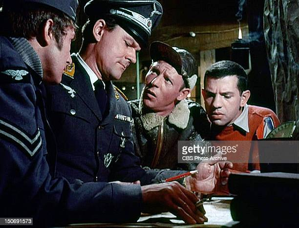 Richard Dawson as Cpl Peter Newkirk Bob Crane as Col Robert E Hogan Larry Hovis as Sgt Andrew Carter and Robert Clary as Cpl Louis LeBeau in the...