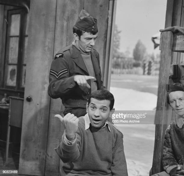 HEROES Richard Dawson as Cpl Peter Newkirk standing and Robert Clary as Cpl Louis LeBeau in The 43rd A Moving Story an episode from the CBS...