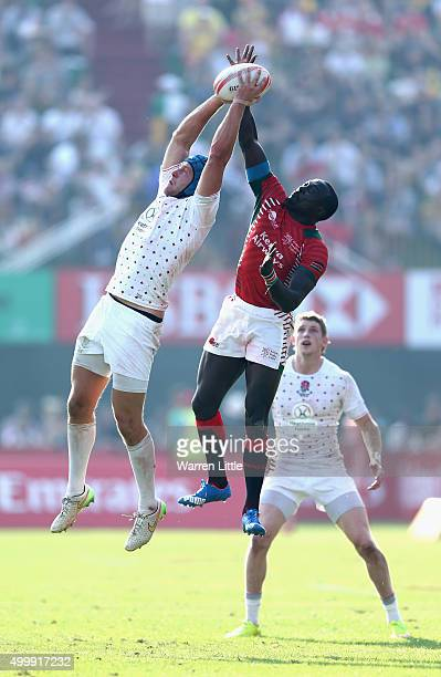 Richard de Carpentier of England jumps against Collins Ouma of Kenya during the Emirates Dubai Rugby Sevens HSBC World Rugby Sevens Series at The...