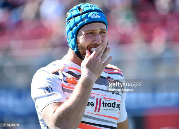Richard de Carpentier of England puts in his mouthguard before facing New Zealand during the USA Sevens Rugby tournament at Sam Boyd Stadium on March...