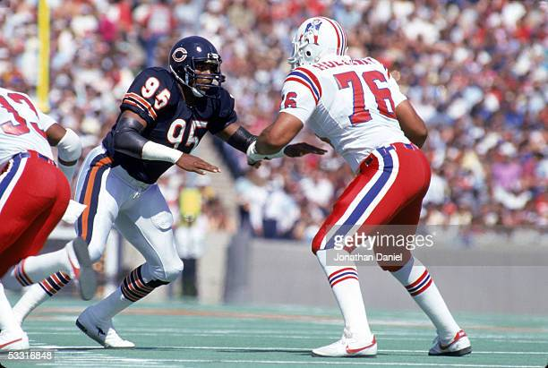 Richard Dent of the Chicago Bears rushes against Brian Holloway of the New England Patriots during the game at Soldier Field on September 15 1985 in...