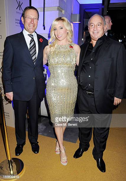 Richard Desmond Joy Canfield and Sir Philip Green attend the Kardashian Kollection launch for Dorothy Perkins at Aqua on November 8 2012 in London...