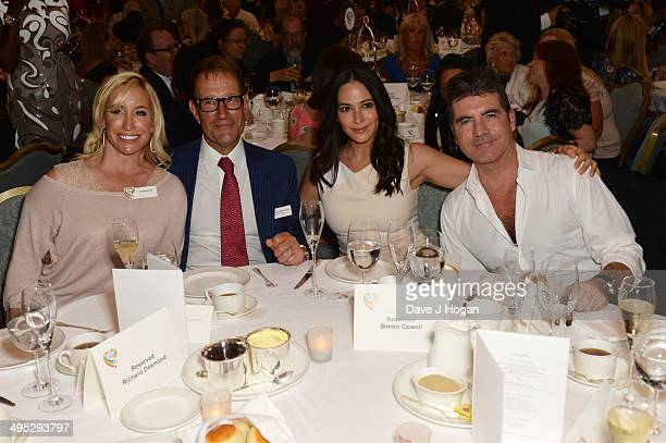 Richard Desmond Joy Desmond Simon Cowell and Lauren Silverman attend the Health Lottery Tea Party at The Savoy on June 2 2014 in London England
