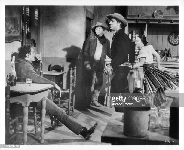 Richard Devon tries to take Robert Loggia's girl Francesca Bellini as John Mitchum looks on in a scene from the film 'Cattle King', 1963.