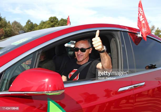 Richard Di Natale leader of the Australian Greens gestures as he leaves in an electric vehicle as part of the 'Stop Adani Convoy' on April 18 2019 in...