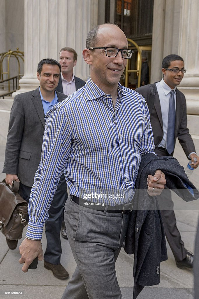 Richard 'Dick' Costolo, chief executive officer of Twitter Inc., center, departs the Ritz-Carlton Hotel in Philadelphia, Pennsylvania, U.S., on Monday, Oct. 28, 2013. The San Francisco-based company is seeking a valuation of 9.5 times 2014 sales in its IPO next month, according to data released in a filing with the Securities and Exchange Commission and analyst projections compiled by Bloomberg. Photographer: Jim Graham/Bloomberg via Getty Images