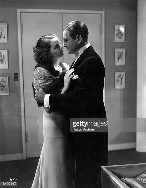 Richard Dix and Elizabeth Allan in a scene from 'No Marriage Ties' directed by J Walter Ruben for RKO In the film Dix plays a supersalesman and...
