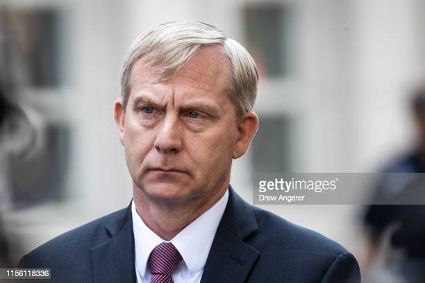 Richard Donoghue, U.S. Attorney for the Eastern District of New York, looks on after speaking to the press following the sentencing hearing for...