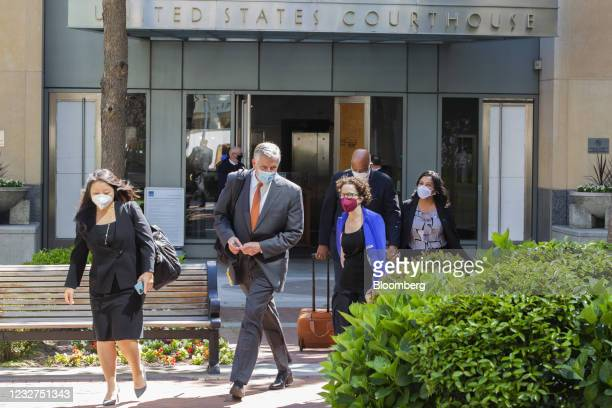 Richard Doren, an attorney for Apple Inc., second from left, exits the U.S. District court in Oakland, California, U.S., on Friday, May 7, 2021. Epic...
