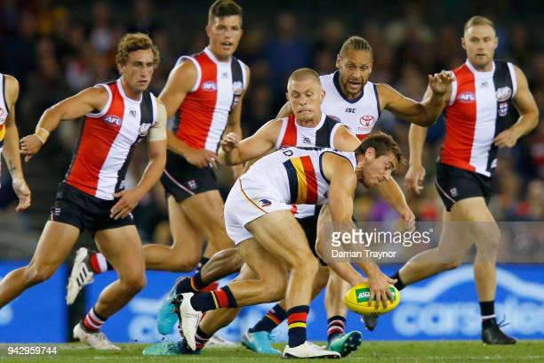 Richard Douglas of the Adelaide Crows gathers the ball during the round three AFL match between the St Kilda Saints and the Adelaide Crows at Etihad...