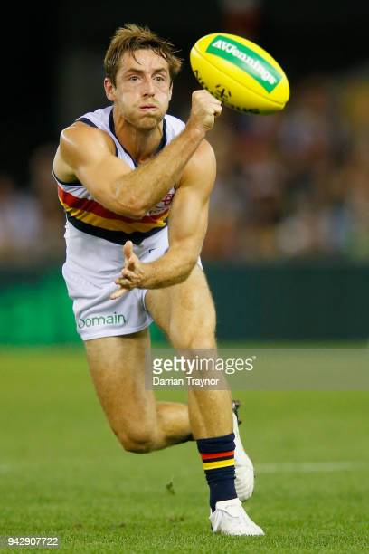 Richard Douglas of the Adelaide Crows handballs during the round three AFL match between the St Kilda Saints and the Adelaide Crows at Etihad Stadium...