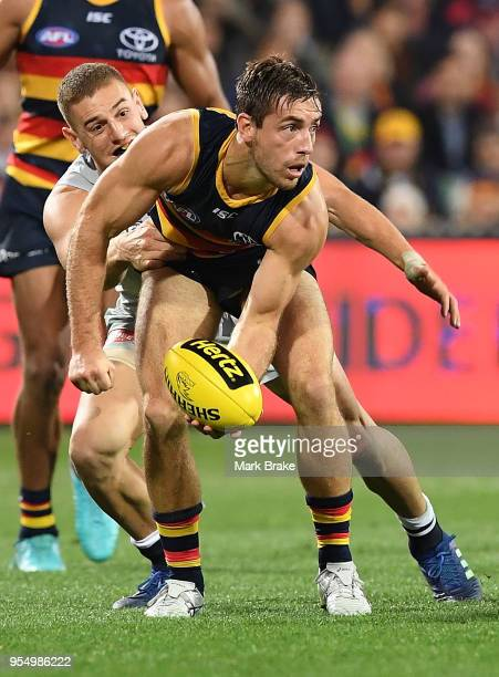 Richard Douglas of the Adelaide Crows handballs during the round seven AFL match between the Adelaide Crows and the Carlton Blues at Adelaide Oval on...