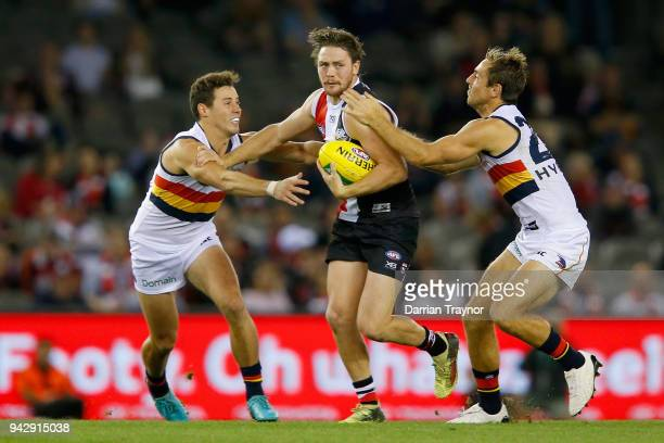 Richard Douglas of the Adelaide Crows tackles Jack Steven of the Saints during the round three AFL match between the St Kilda Saints and the Adelaide...