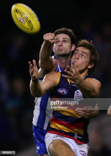 Richard Douglas of the Crows and Bradley Rawlings of the Kangaroos compete for the ball during the round eight AFL match between the North Melbourne...