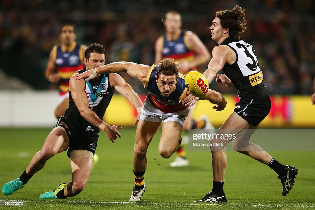 Richard Douglas of the Crows competes for the ball with Travis Boak and Darcy Byrne-Jones of the Power during the round 22 AFL match between the Port Adelaide Power and the Adelaide Crows at Adelaide Oval on August 20, 2016 in Adelaide, Australia.