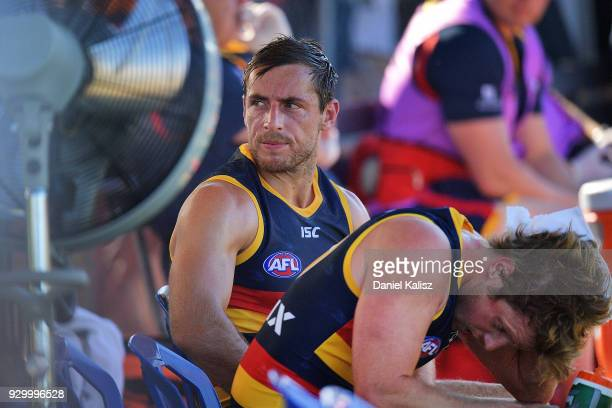 Richard Douglas of the Crows cools off on the bench during the JLT Community Series AFL match between Port Adelaide Power and the Adelaide Crows at...