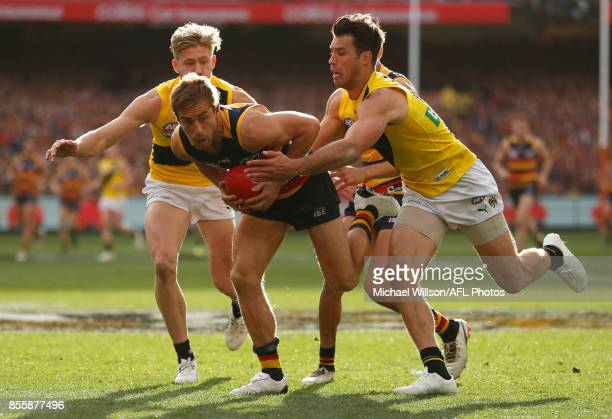 Richard Douglas of the Crows is tackled by Alex Rance of the Tigers during the 2017 Toyota AFL Grand Final match between the Adelaide Crows and the...