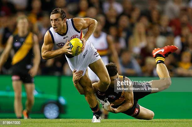 Richard Douglas of the Crows is tackled by Trent Cotchin of the Tigers during the 2016 AFL Round 03 match between the Richmond Tigers and the...