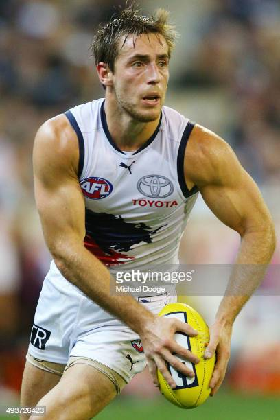 Richard Douglas of the Crows looks upfield with the ball during the round 10 AFL match between the Carlton Blues and the Adelaide Crows at Melbourne...