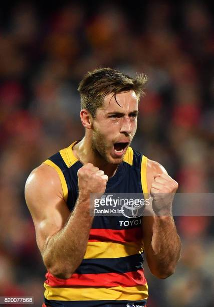 Richard Douglas of the Crows reacts after kicking a goal during the round 18 AFL match between the Adelaide Crows and the Geelong Cats at Adelaide...